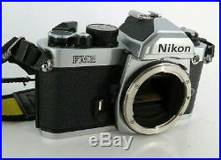 Nikon FM2 35mm SLR Film Camera Silver Body Only W strap For Parts / Repair As Is