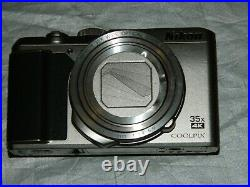 USED Nikon COOLPIX A900 35x Zoom 20.3 MP Camera SILVER 4 parts or repair AS IS